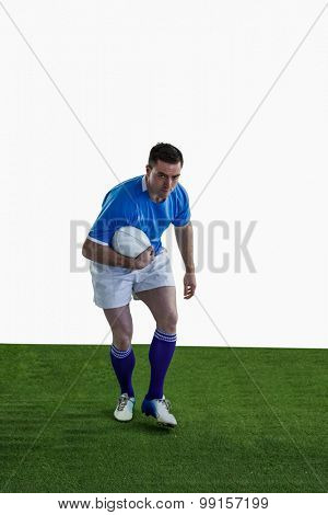 Portrait of a rugby player running with the rugby ball