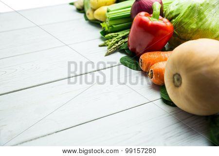 Line of vegetables on table shot in studio