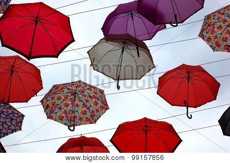 lot of colorful umbrellas in the sky