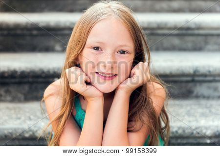 Close up portrait of a cute little girl of 7-8 years old