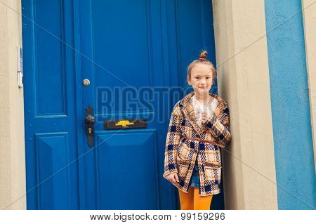 Fashion portrait of a cute little girl, wearing warm knitted cardigan