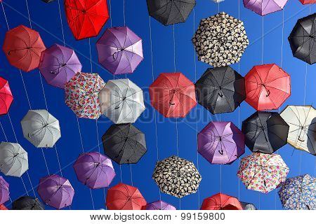 a lot of colorful umbrellas in the sky