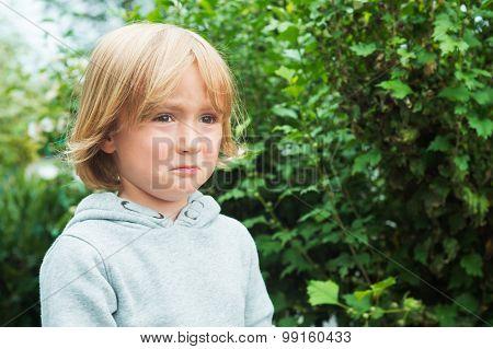 Close up portrait of a sad little boy