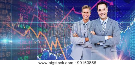 Business team standing arms crossed against stocks and shares Business team standing arms crossed against a white screen