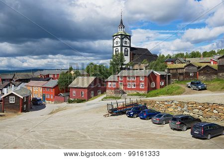 View to the traditional wooden houses and church bell tower of the copper mines in Roros, Norway.