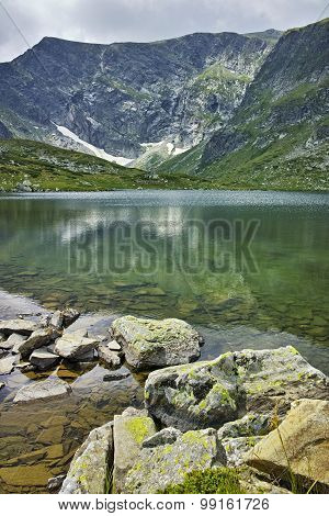 Reflection of Rila Mountain in The Trefoil lake