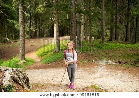 Little hiker girl in forest. Photo from Champex-Lac, Valais, swiss Alps