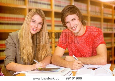 Students studying against close up of a bookshelf