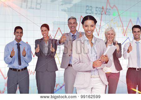 Happy business people looking at camera with thumbs up against stocks and shares