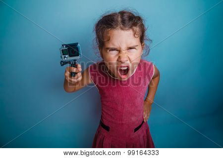 teen girl holding a camera action screams mouth opened photo stu