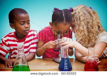 Cute pupil looking through microscope against blue vignette background
