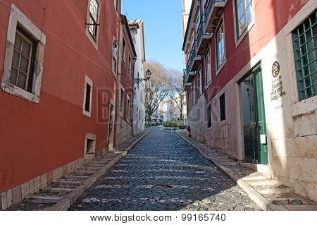 Typical Small Tidy Road In The Old Part Of City Lisbon