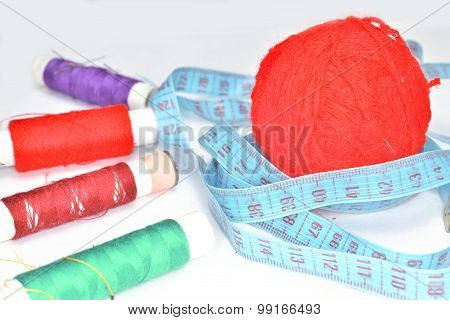 Purple Yarn, Blue  Ruler And Many Colored Clew