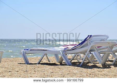 Sunbed Near Sea On Sand