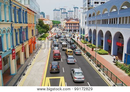 View to the colorful street with cars passing by in Singapore, Singapore.