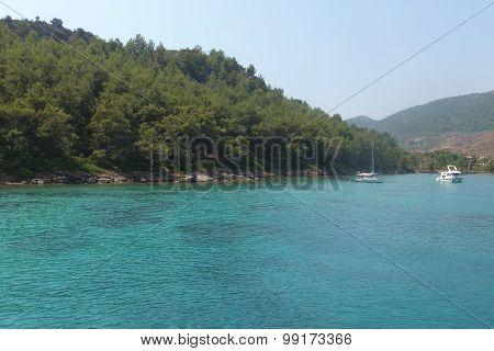 Aegean sea, view of the island, boats on the shore of the beautiful sea