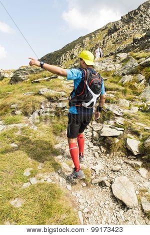 Hiker running on mountain