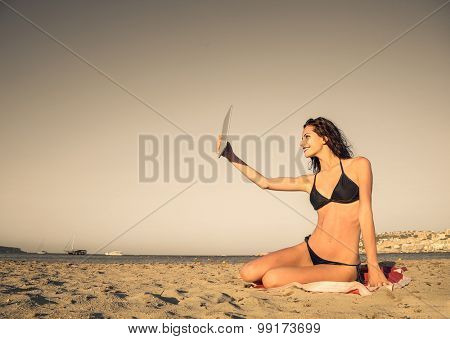 Girl taking a selfie at the beach