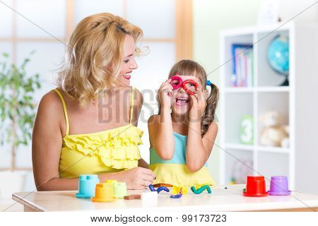 woman and kid have fun pastime making handcraft at home