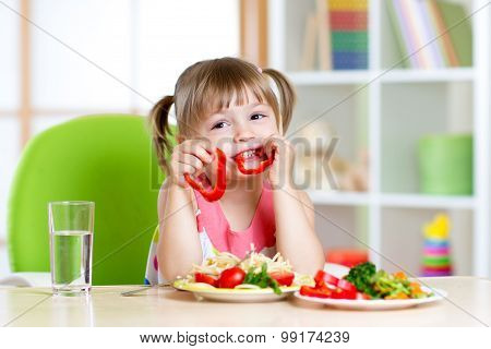 child eats healthy food in kindergarten or at home
