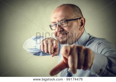 Businessman pointing directly at the camera