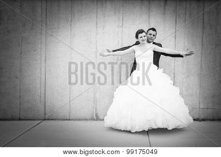 Bride And Groom Spreading Arms Bw