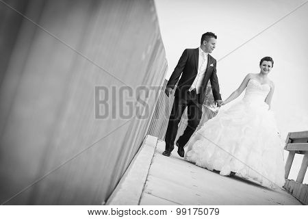 Bride And Groom Walking In City Bw