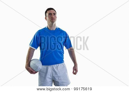 Portrait of a smiling rugby player holding a rugby ball