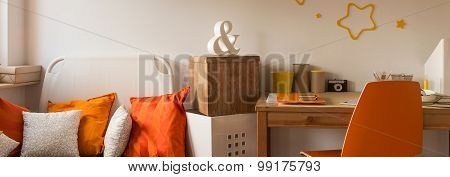 Orange Chair And Simple Desk