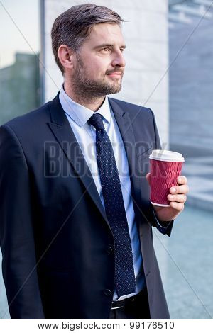 Young Boss Drinking Takeaway Coffee