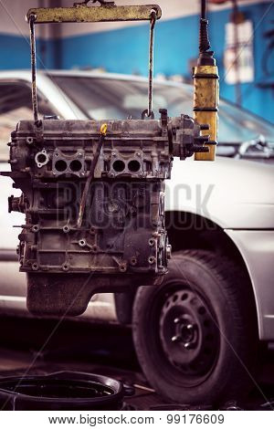 Car Engine Hanging In Workshop