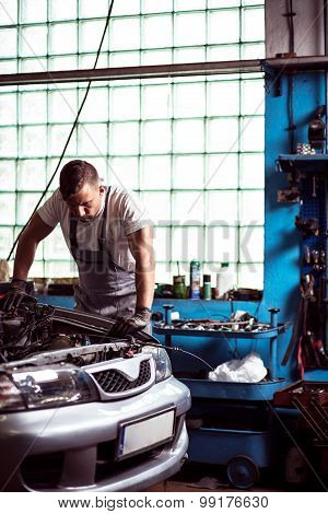 Mechanic Diagnosing Car Engine