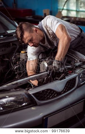 Professional Car Technician During Labor