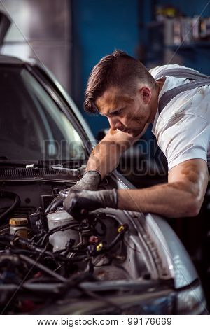 Young Handsome Man Servicing Vehicle