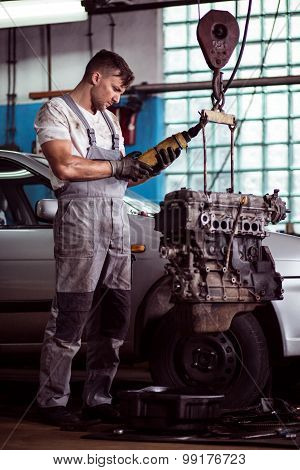 Auto Mechanic Inspecting Motor Car