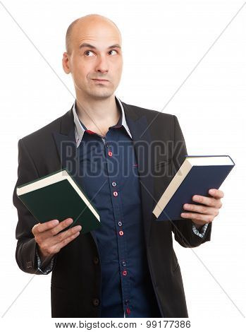 Confused Man Holding Two Books In Hands