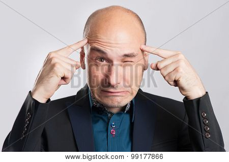 Frustrated Business Man With A Headache