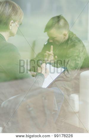 Psychiatrist Listening Male Soldier