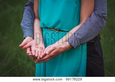 Hands Holding Rings