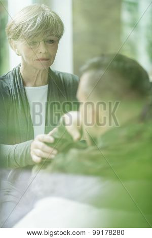 Psychiatrist Comforting Military Patient