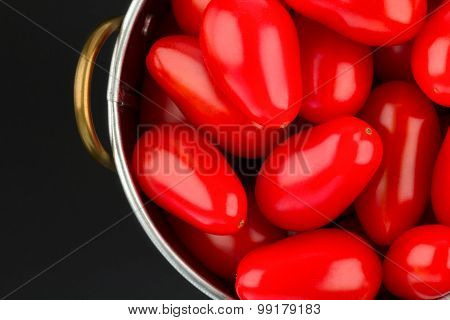 Container of ripe red tomatoes