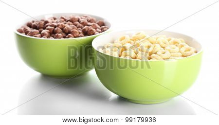Delicious and healthy cereal in bowls isolated on white