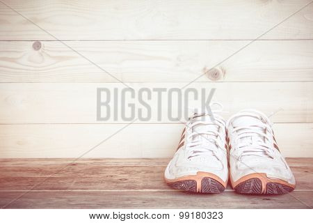Sport Shoes On A Wood Floor