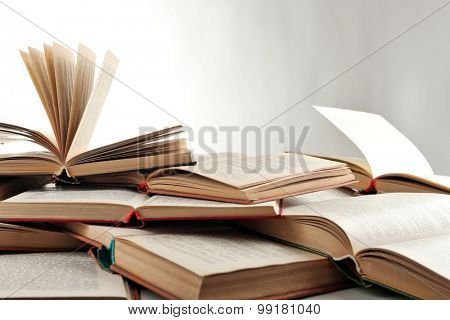 Many open books isolated on white
