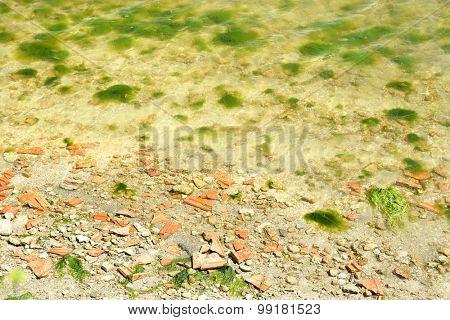 Broken stones over water background
