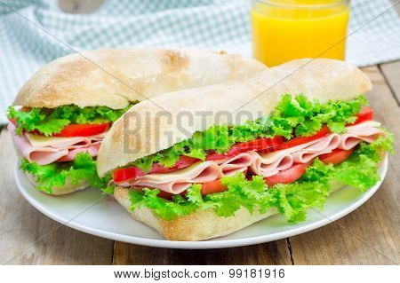 Healthy Ciabatta Bread Sandwiches With Ham And Cheese On The White Plate
