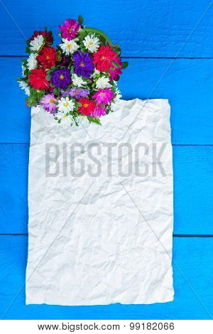 Flower bouquet and sheet of paper