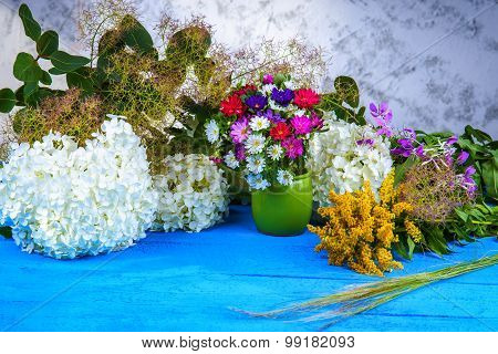 Mixed flowers on a wooden table