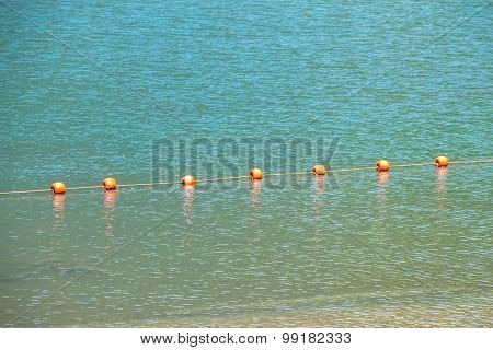 Photo of a mountain lake with buoys