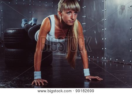 sporty athlete woman doing push ups on tire strength power training concept cross fit fitness workou